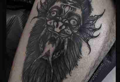 "alt=""black work tattoo double face"""
