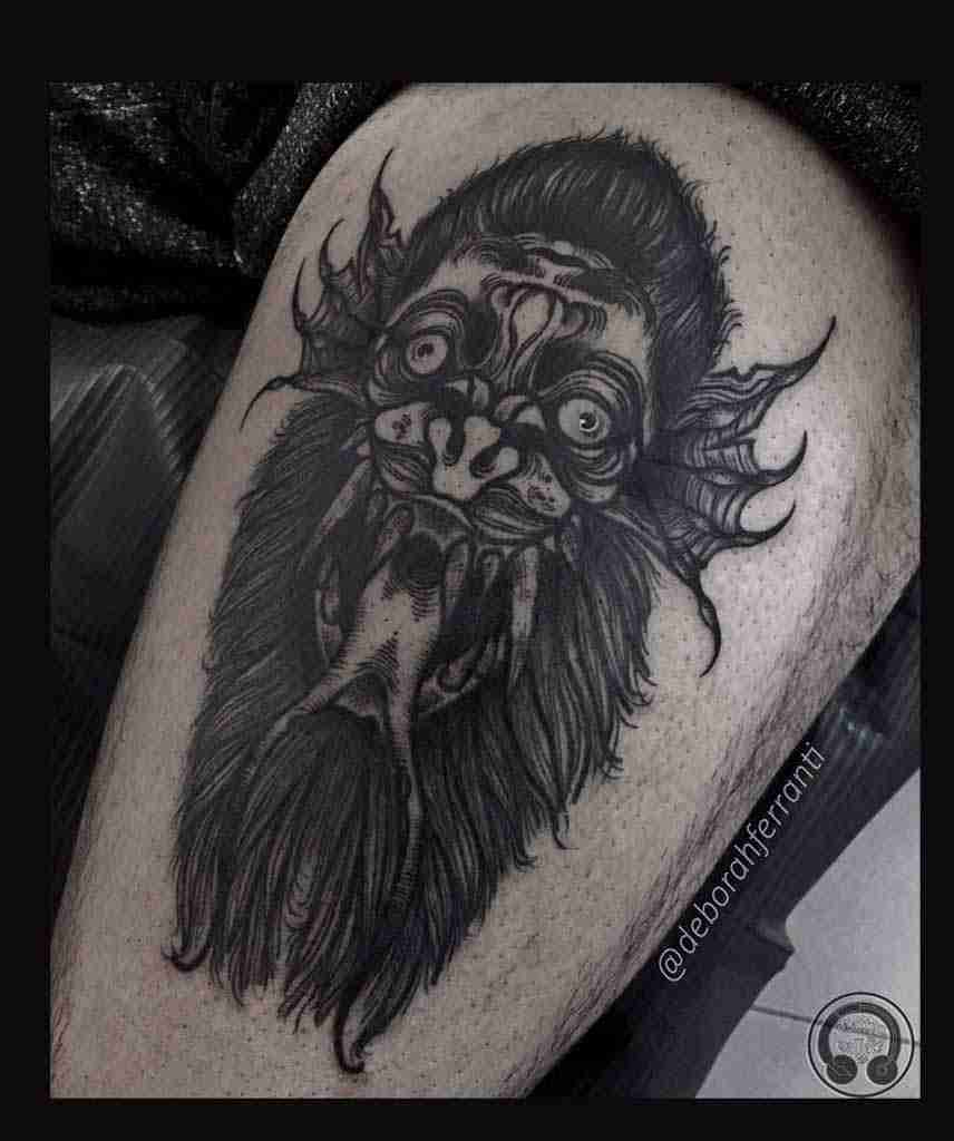 "alt=""black work tattoo double face"""