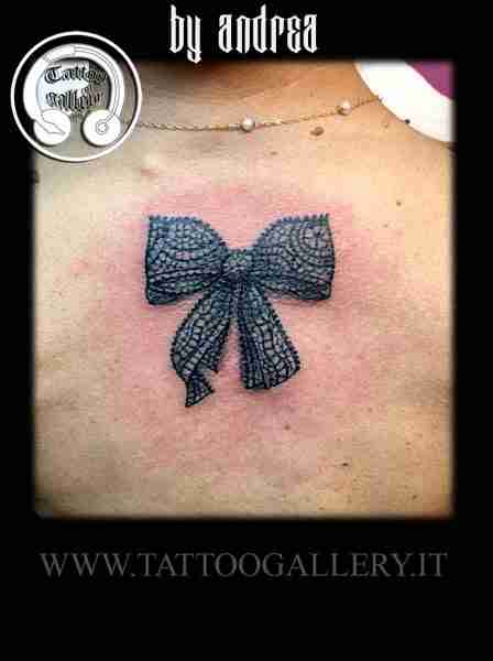 """alt=""""realistic tattoo fiocco by Andrea"""""""