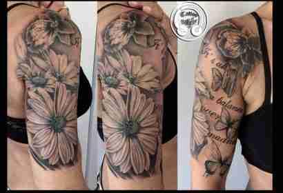 "alt=""tatuaggi fiori realistici gerbere"""